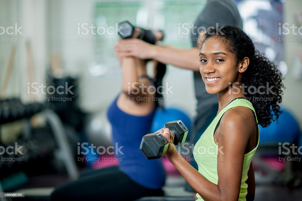 Woman Lifting Free Weights at the Gym stock photo