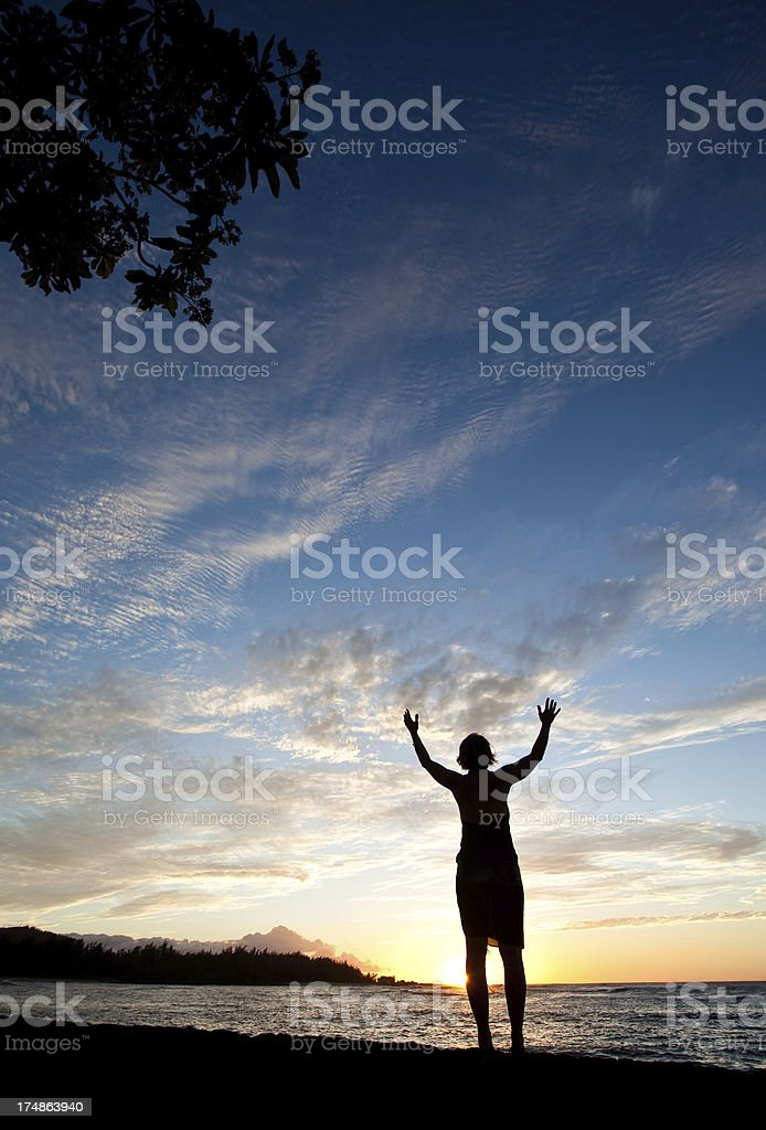 Woman Lifting Hands to the Sky in Worship royalty-free stock photo