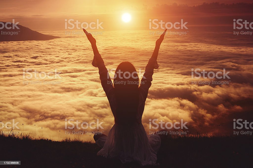 Woman lifting her arms in immense joy royalty-free stock photo