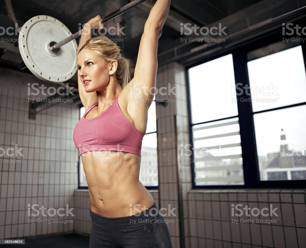 Woman Lifting Weight stock photo