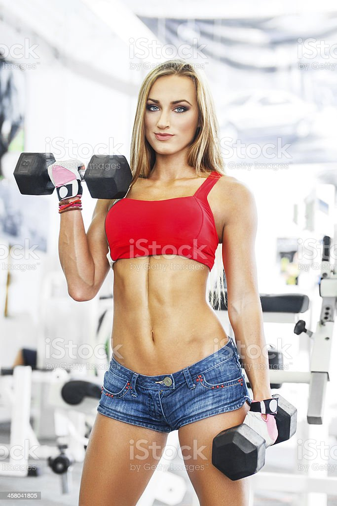 Woman lifting weights in a training session royalty-free stock photo