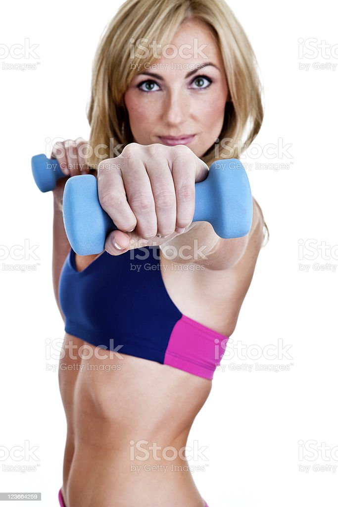 Woman lifting weights selective focus royalty-free stock photo