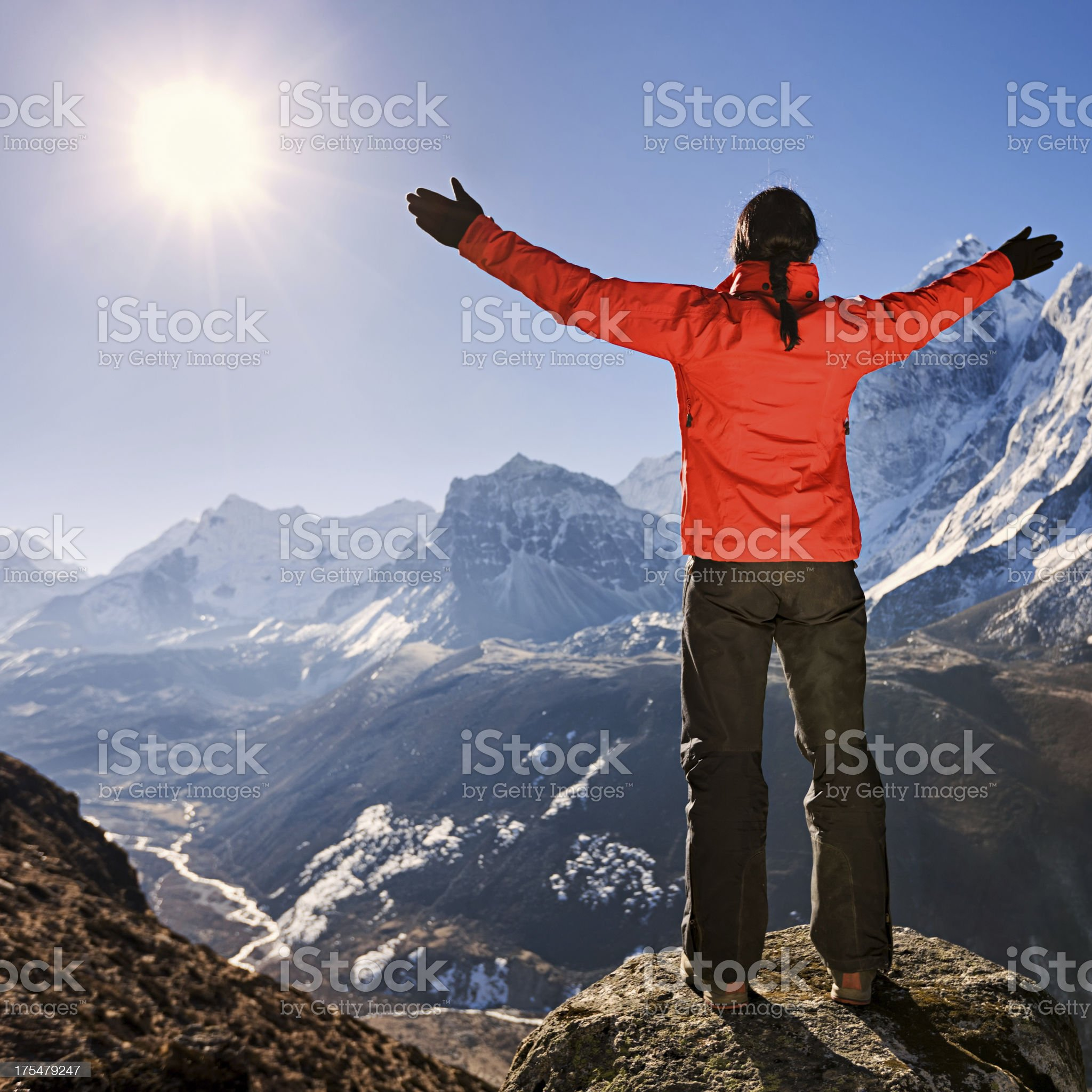 Woman lifts her arms in victory, Mount Everest National Park royalty-free stock photo