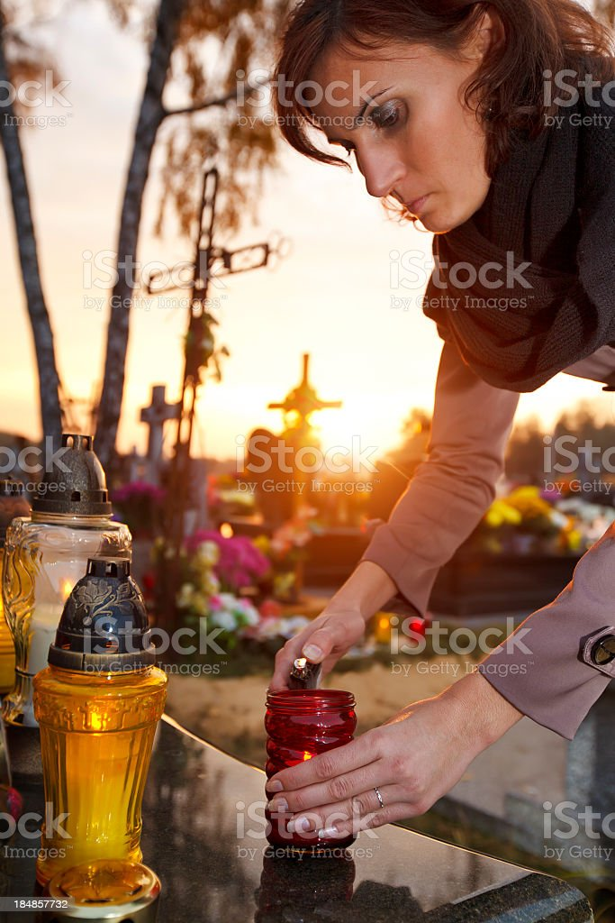 Woman lights a candle royalty-free stock photo