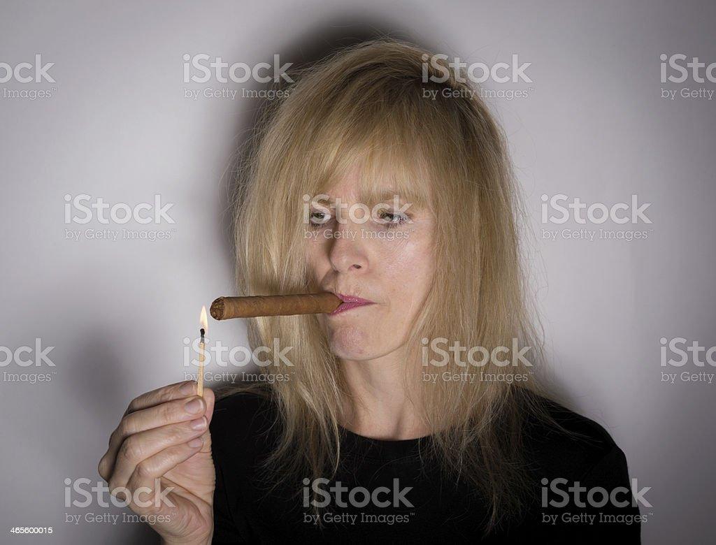 Woman Lights a Cigar royalty-free stock photo