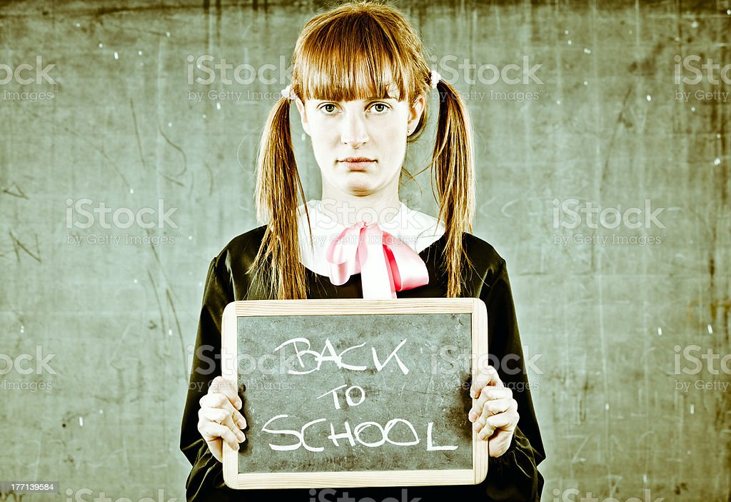 Woman like Kid. Back to school concept royalty-free stock photo