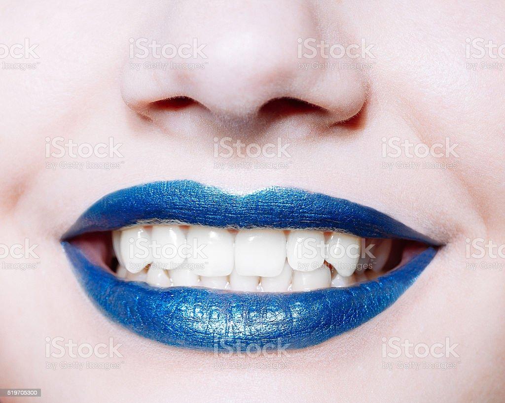 Woman lips with glossy blue lipstick stock photo