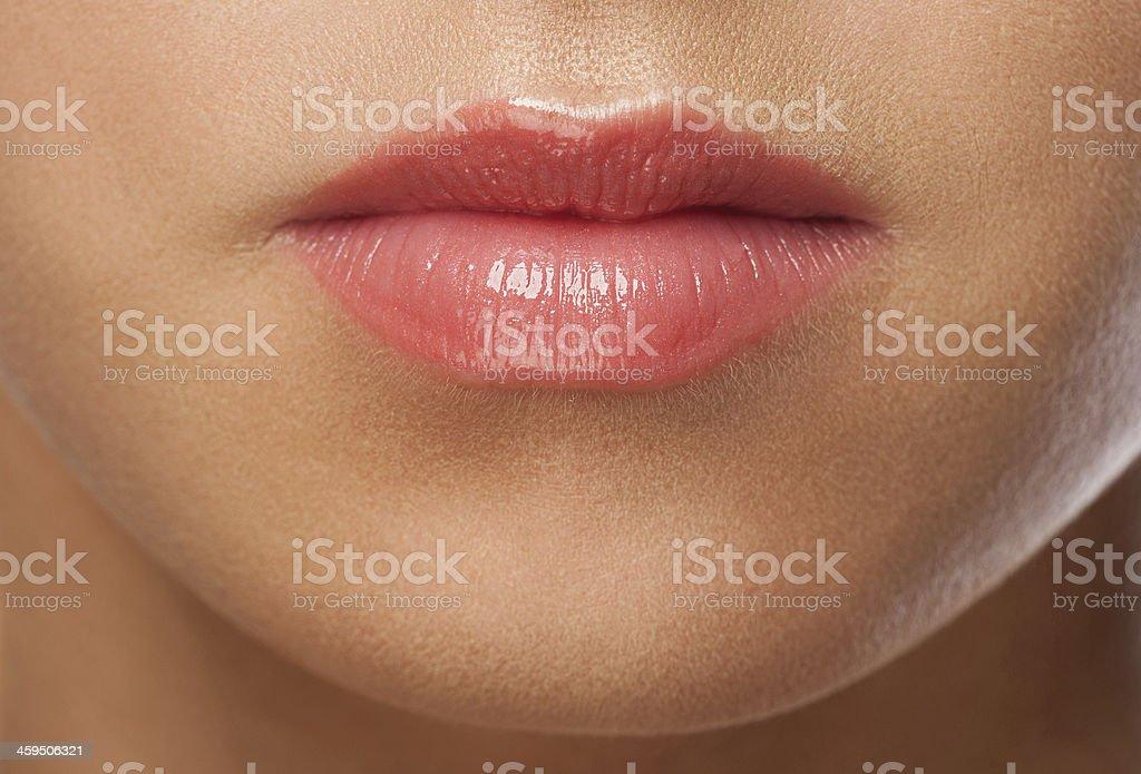 Woman lips with pink  lipstick stock photo