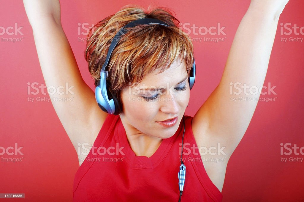 Woman listen to music royalty-free stock photo