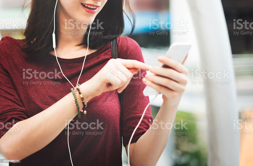 Woman Listening Music Media Entertainment Walking Concept stock photo