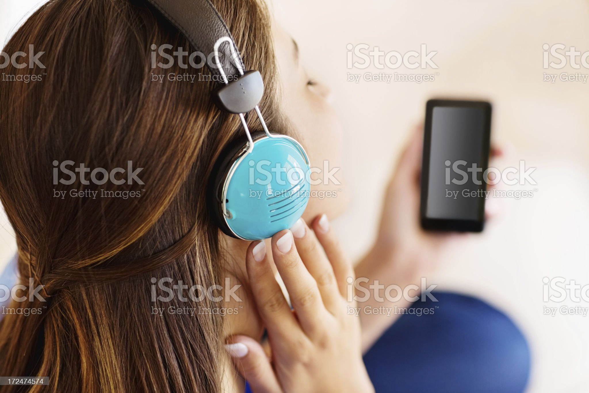 Woman Listening Music On Headphones royalty-free stock photo