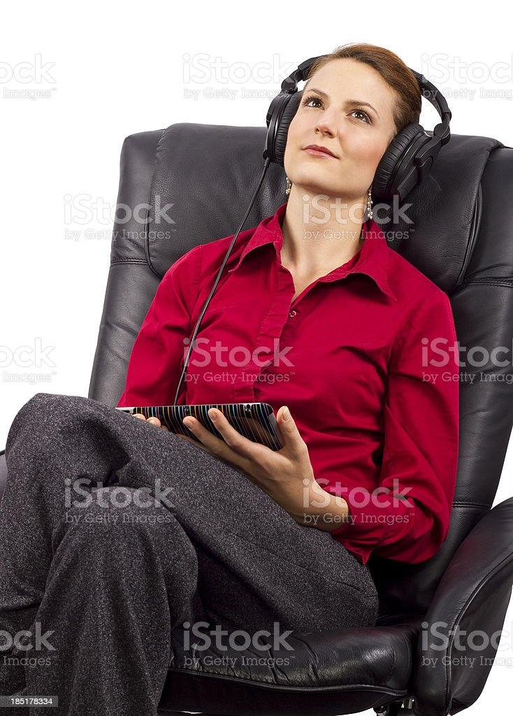 Woman Listening To Audio Books on a Tablet royalty-free stock photo