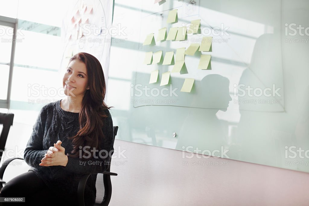 Woman listening to colleagues in studio office stock photo