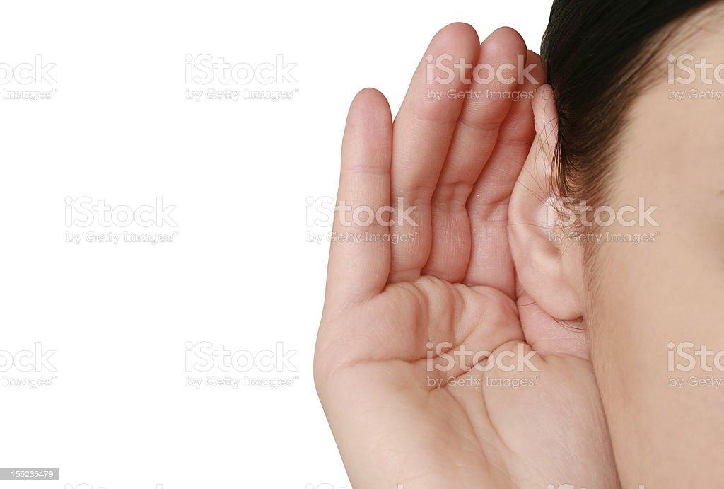 woman listening to gossip stock photo