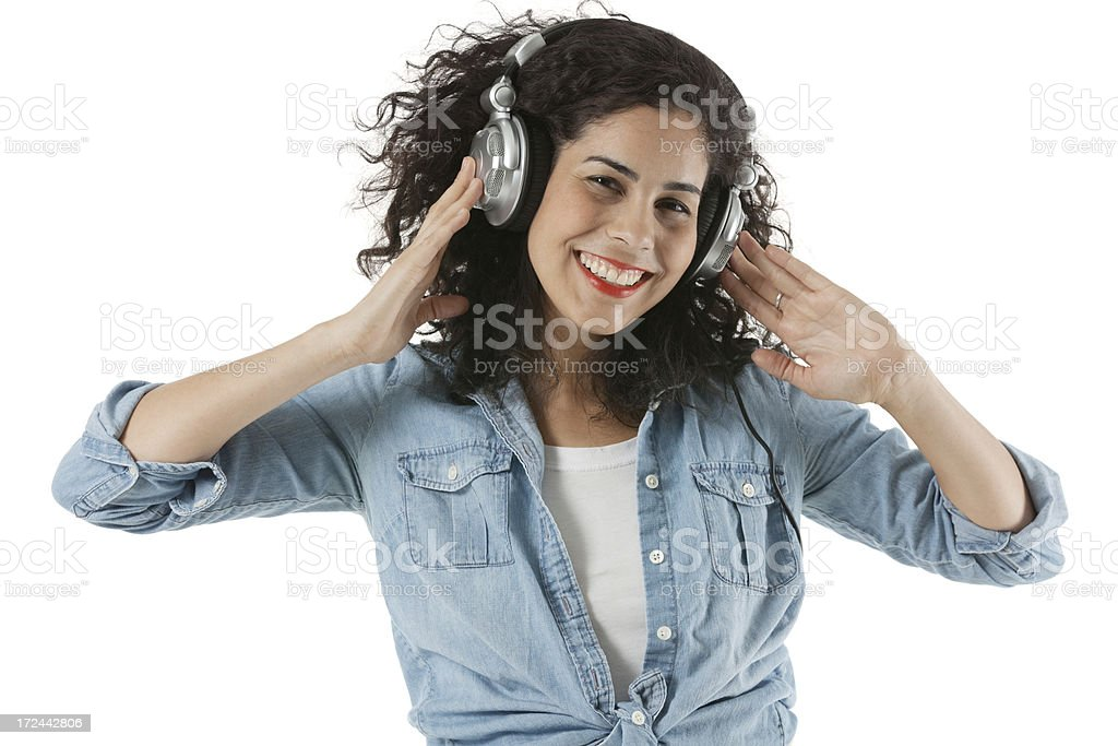 Woman listening to headphones royalty-free stock photo