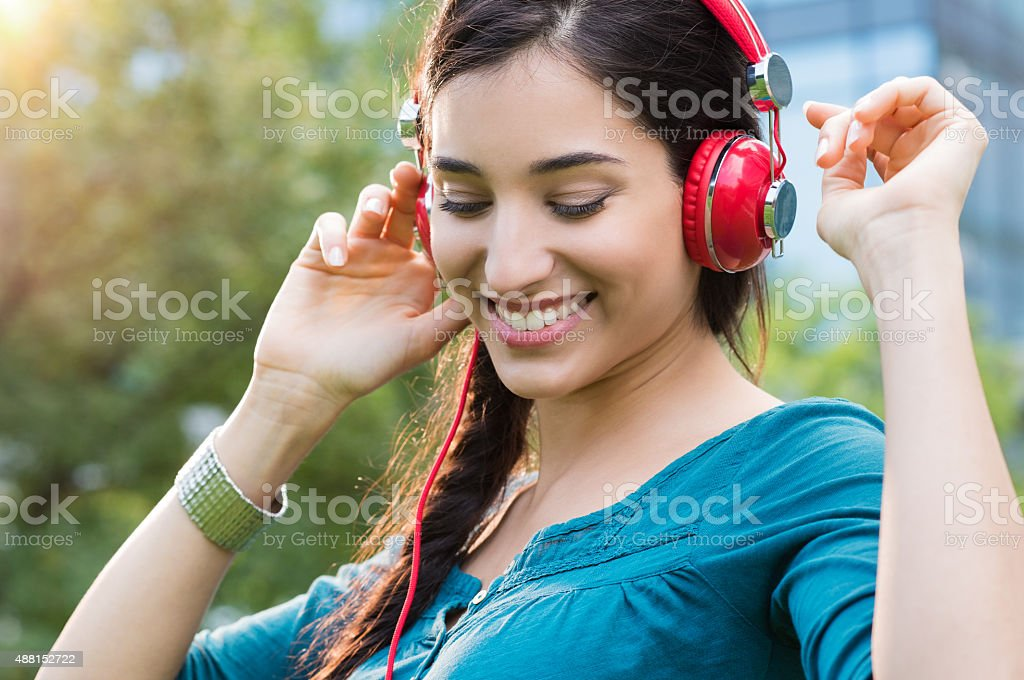 Woman listening to music and dancing stock photo