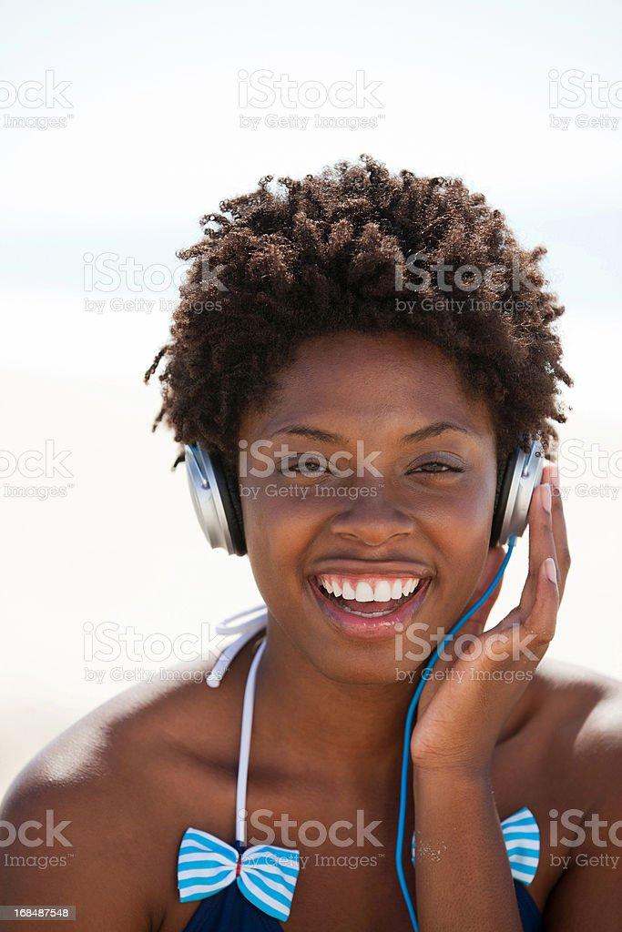 Woman listening to music on headphones royalty-free stock photo