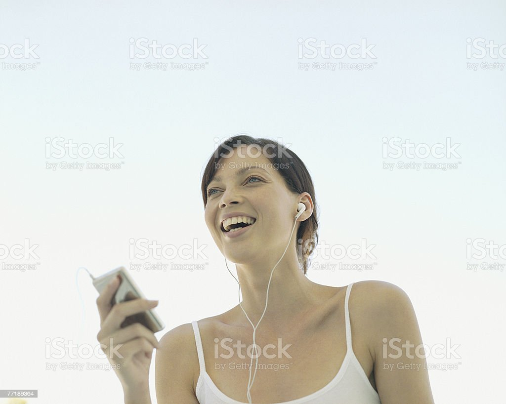 A woman listening to music royalty-free stock photo