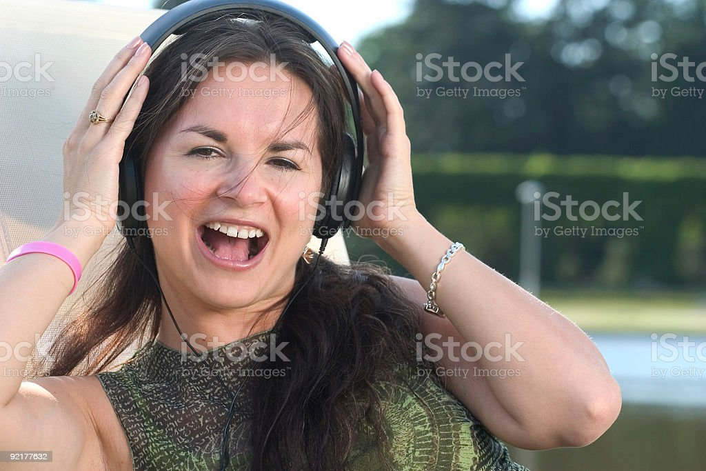 Woman listening to music royalty-free stock photo