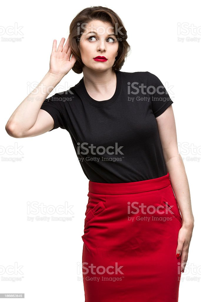Woman Listening With Hand to Ear stock photo