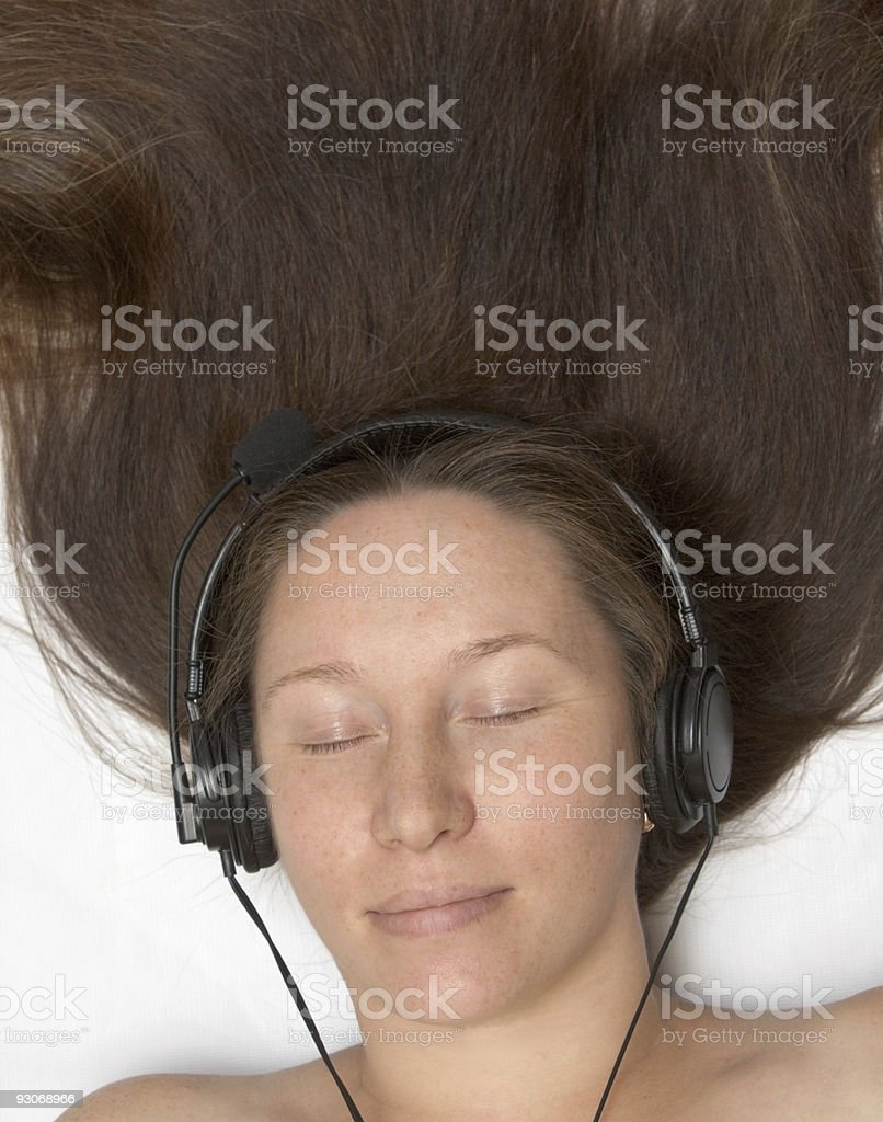 woman listens to music stock photo