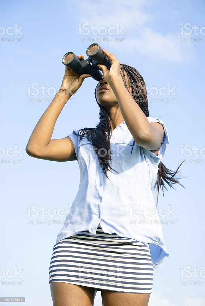 Woman llooking through binoculars royalty-free stock photo