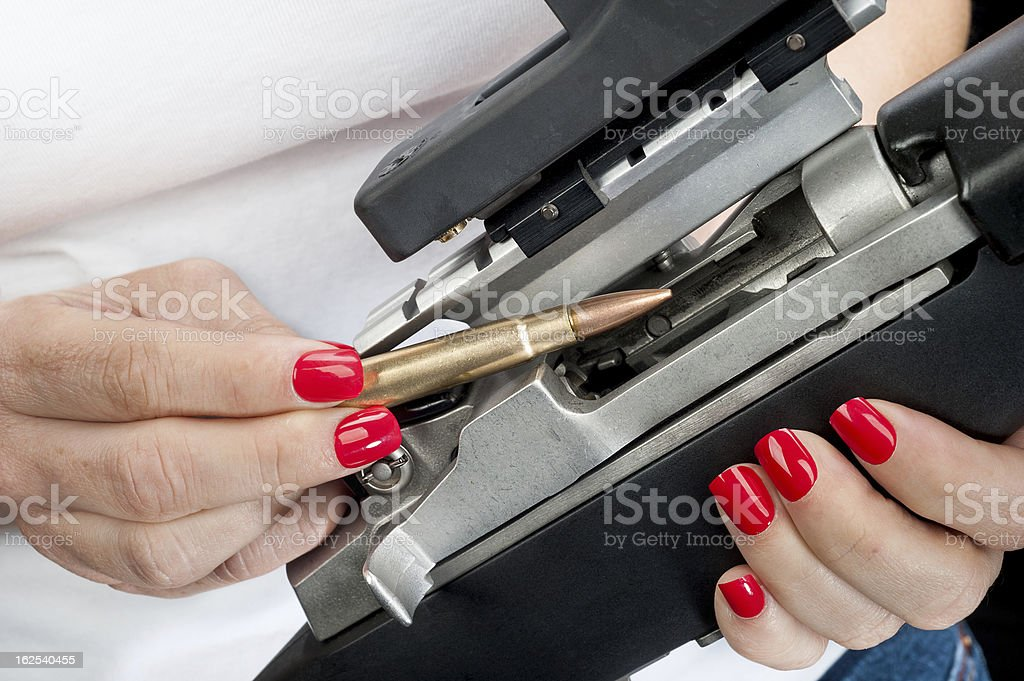 Woman loading rifle royalty-free stock photo
