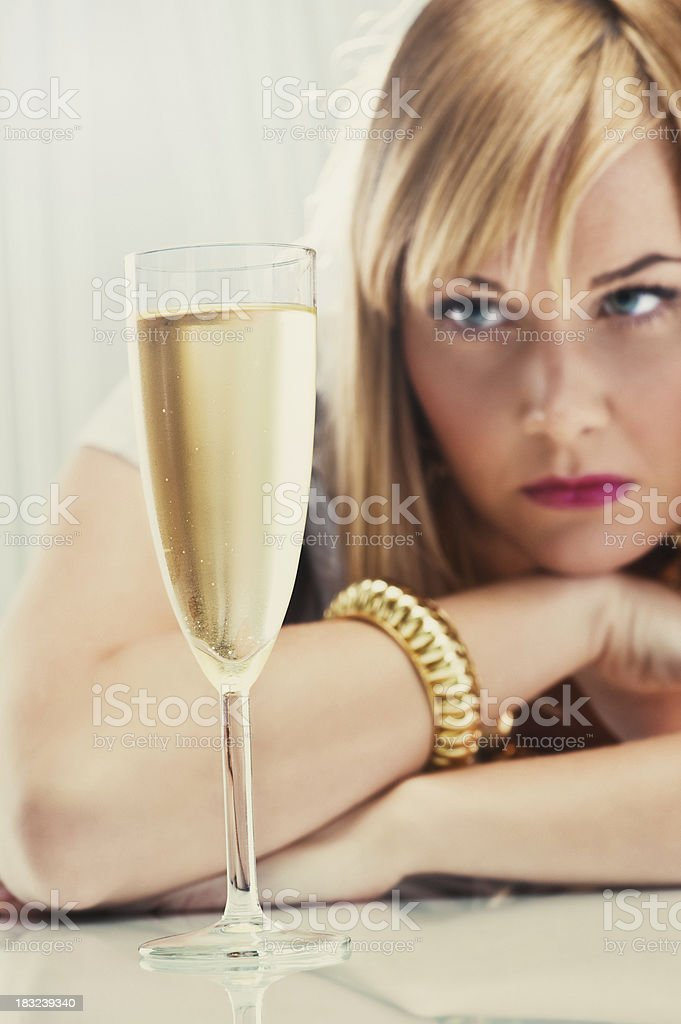 Woman loking at a champagne glass royalty-free stock photo