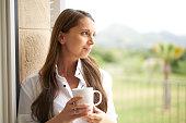woman long hair cup of tea pensive