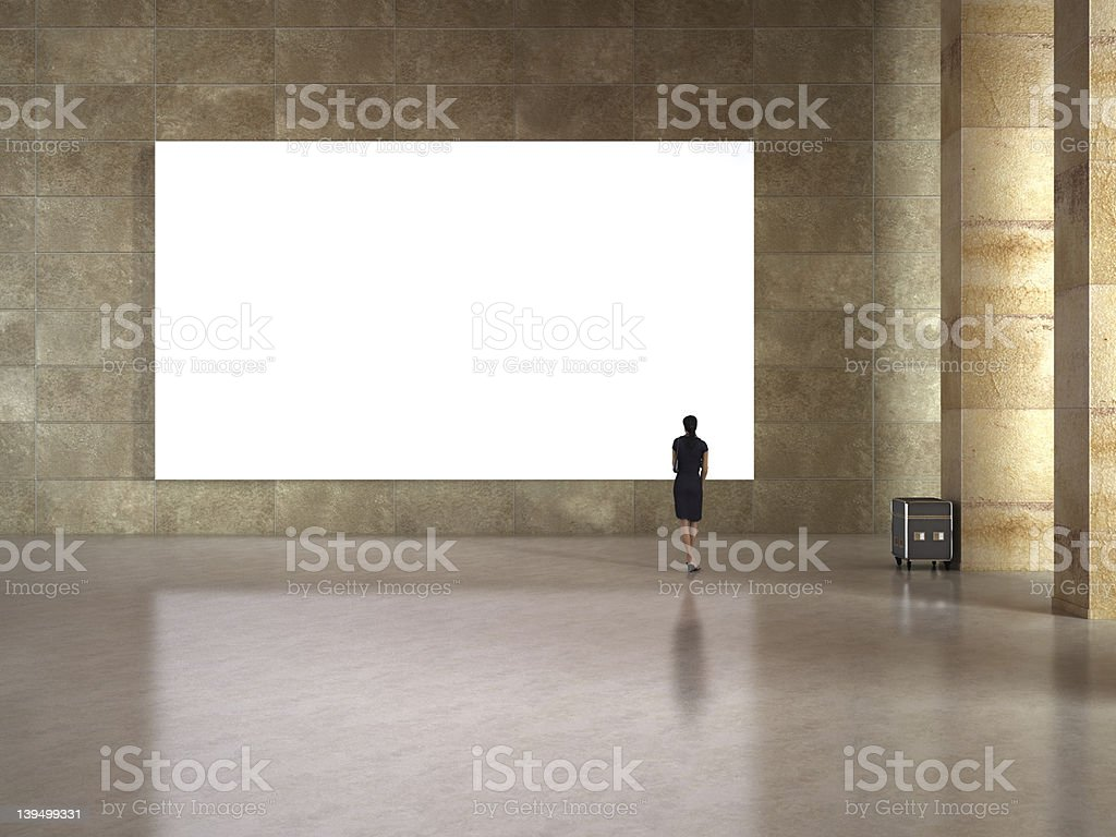 Woman look at the blank frame in art gallery royalty-free stock photo