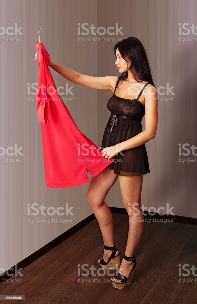 woman look on a red dress stock photo
