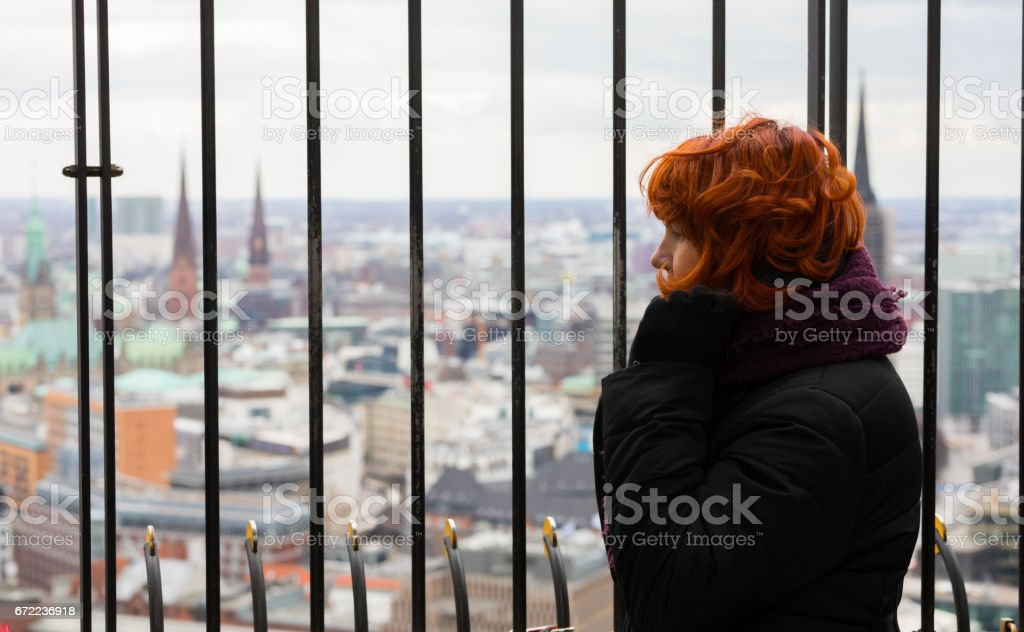 Woman look to the aerial view Hamburg, Germany stock photo
