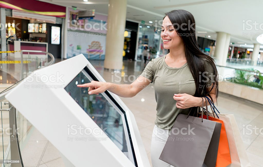 Woman looking at a map at the shopping center stock photo