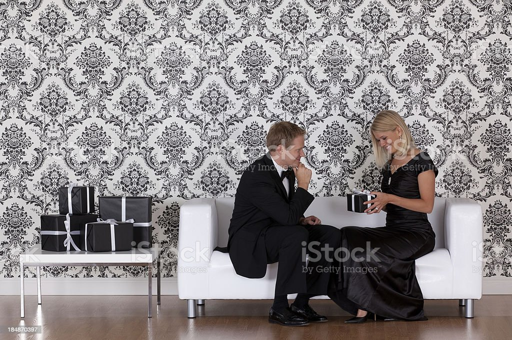 Woman looking at a present given by her husband royalty-free stock photo