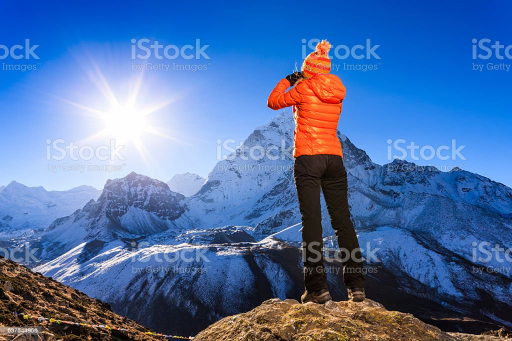 Woman looking at Ama Dablam, Mount Everest National Park, Nepal stock photo