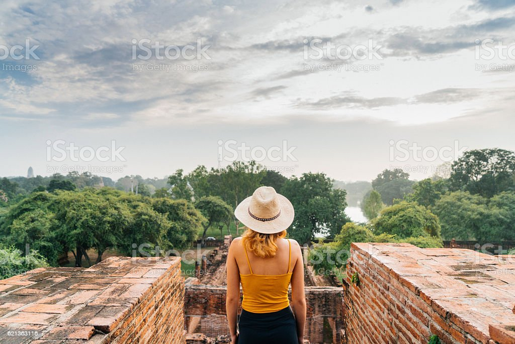 Woman looking at ancient Buddhist Temple stock photo