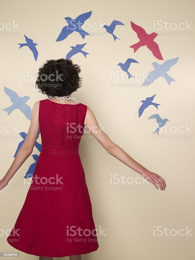 Woman looking at birds stock photo