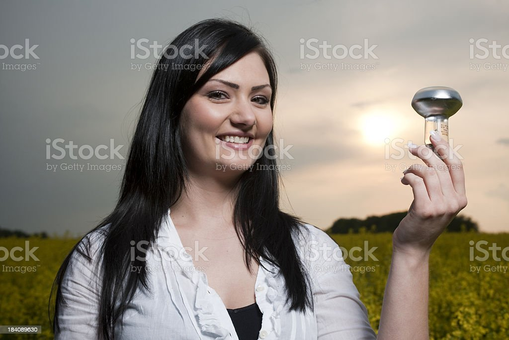Woman looking at bulb stock photo