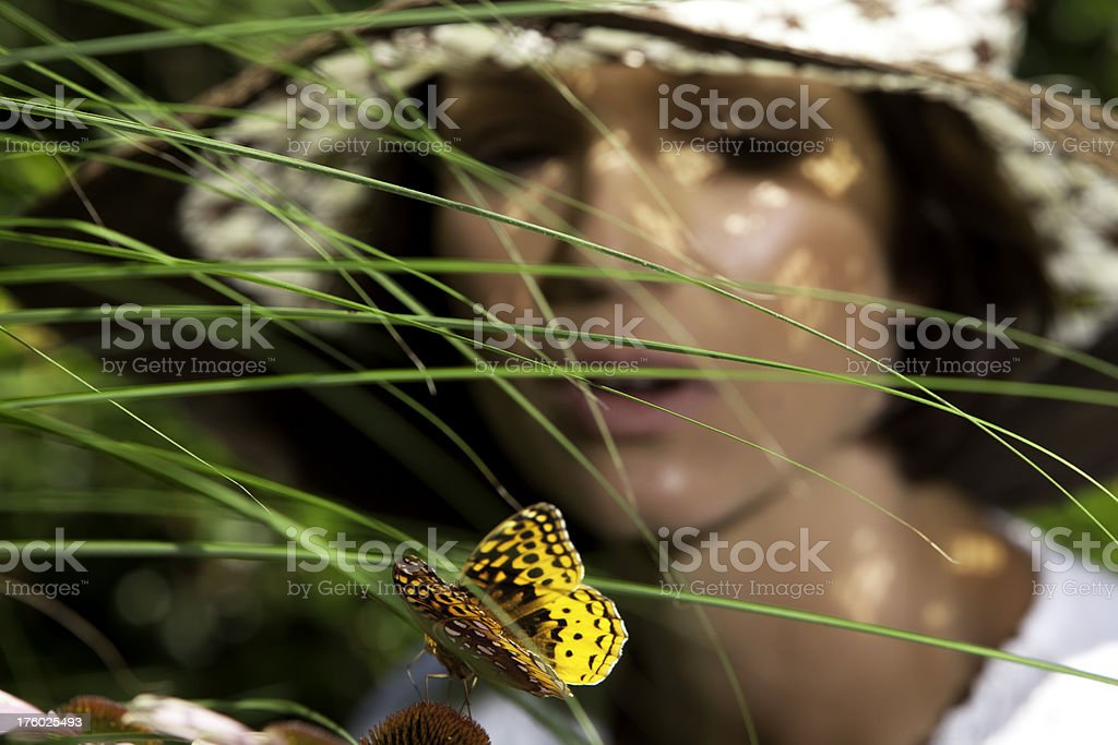Woman looking at butterfly royalty-free stock photo