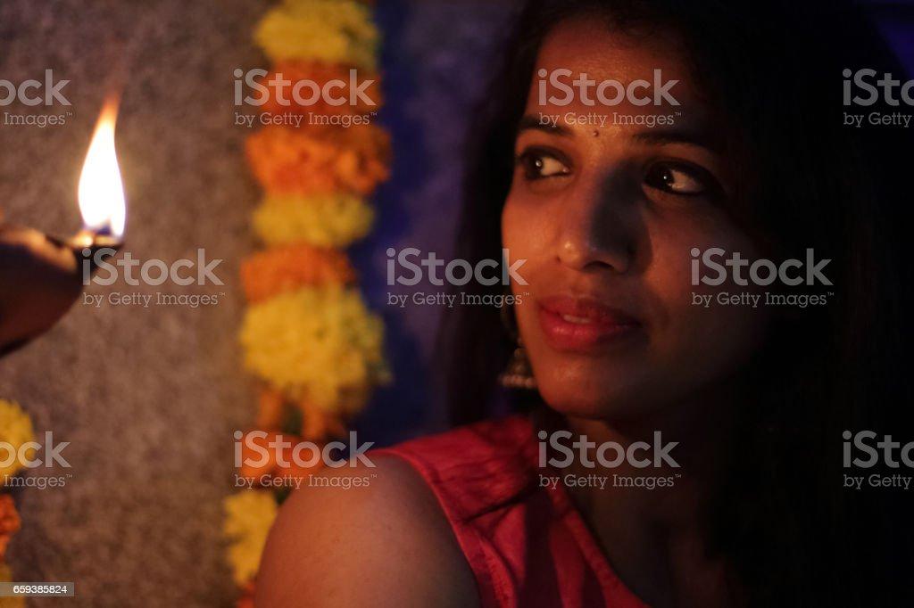 Woman Looking at Diya stock photo