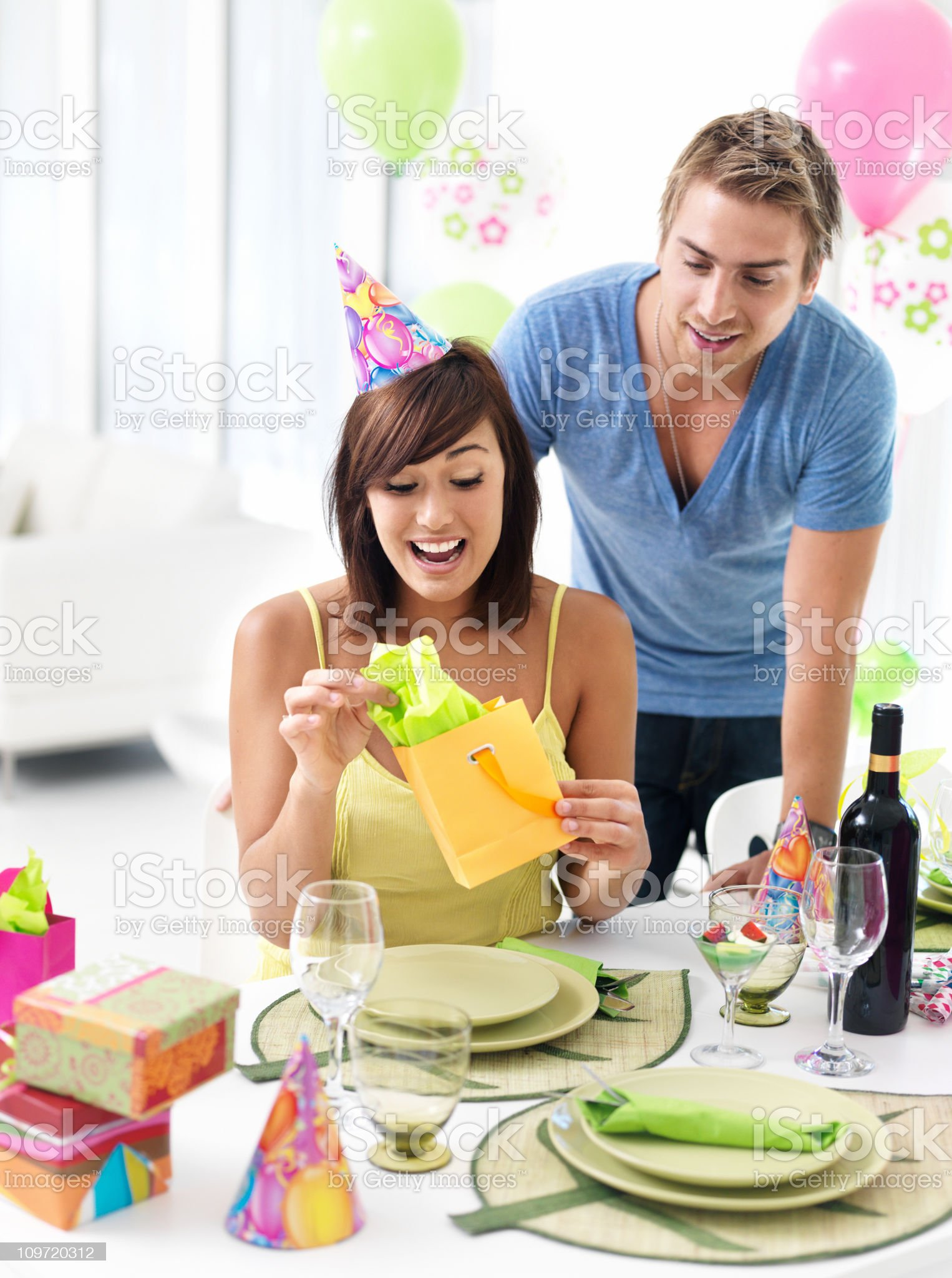 Woman looking at gift royalty-free stock photo