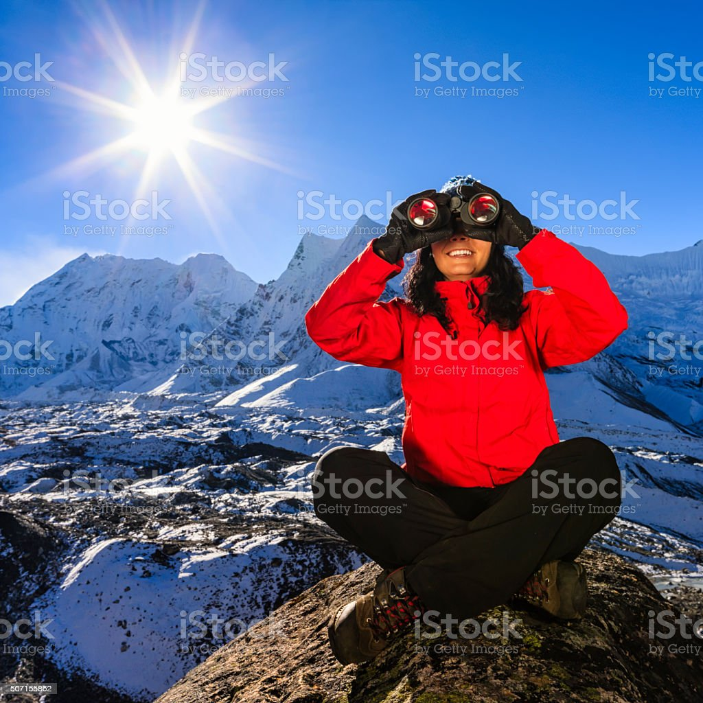 Woman looking at Himalayas, Mount Everest National Park, Nepal stock photo