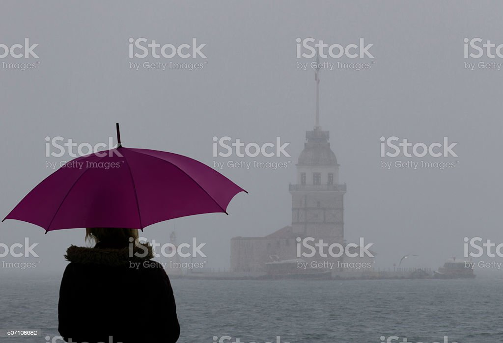 Woman looking at Maiden's Tower stock photo