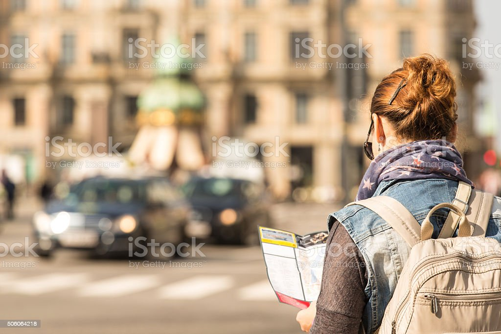 Woman looking at map in the city stock photo