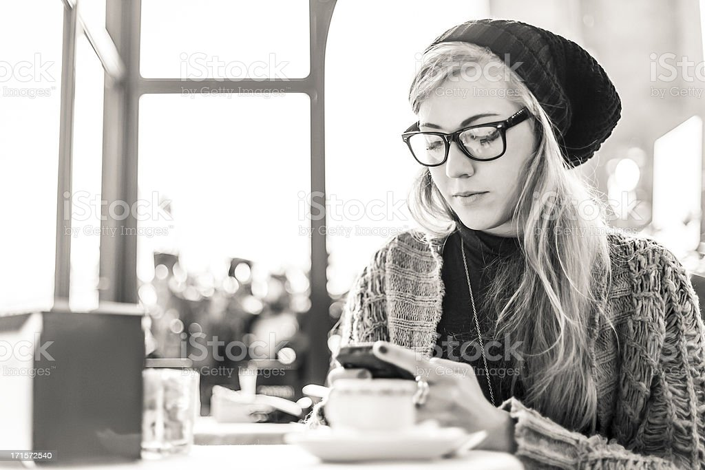 Woman looking at mobile phone royalty-free stock photo