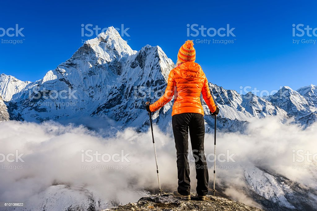 Woman looking at Mount Ama Dablam, Mount Everest National Park stock photo