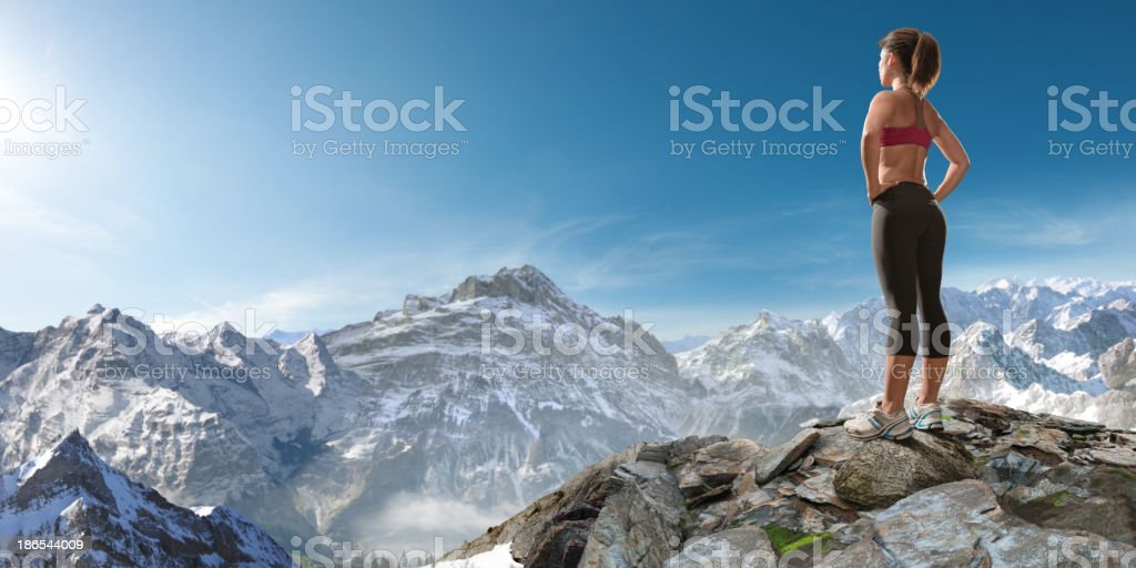 woman looking at mountains stock photo