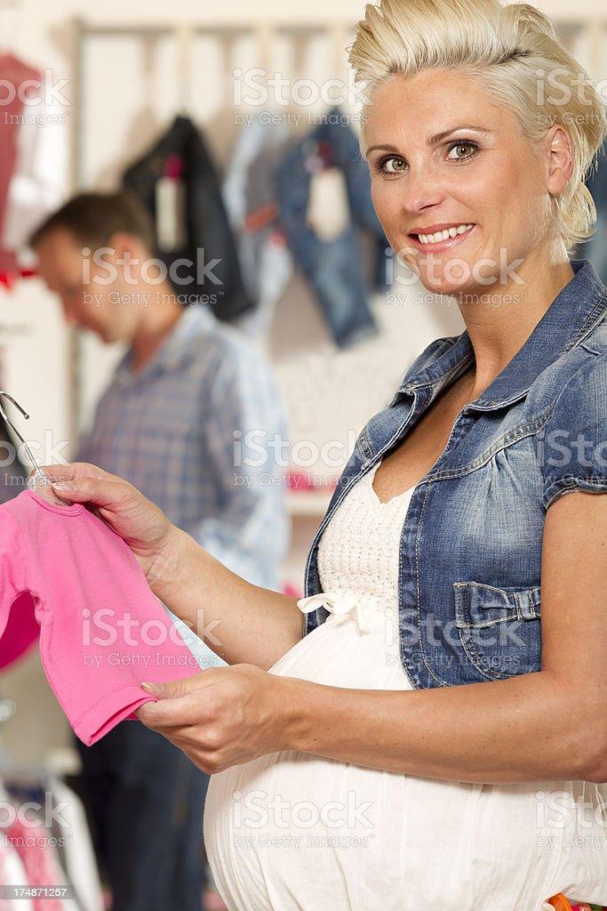 Woman looking at new baby clothing royalty-free stock photo