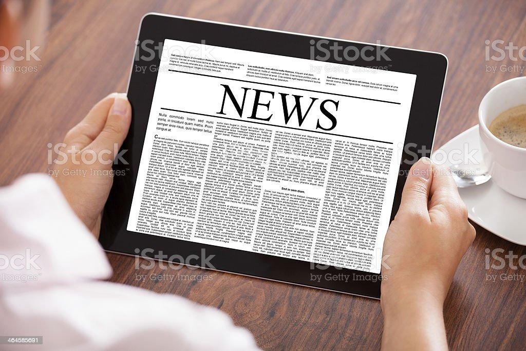 Woman Looking At News Article stock photo