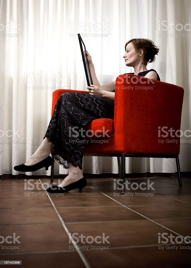 Woman Looking at Picture stock photo